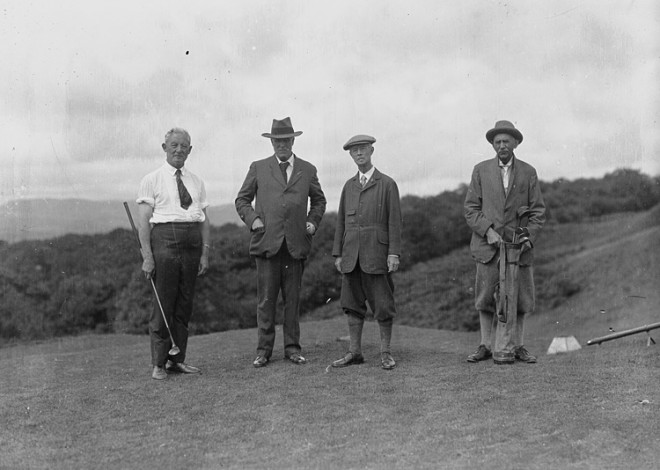 Four_gentlemen_golfers_on_the_tee_of_a_golf_course_(5014828806)