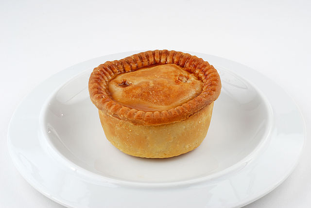 Pork pie on a plate.